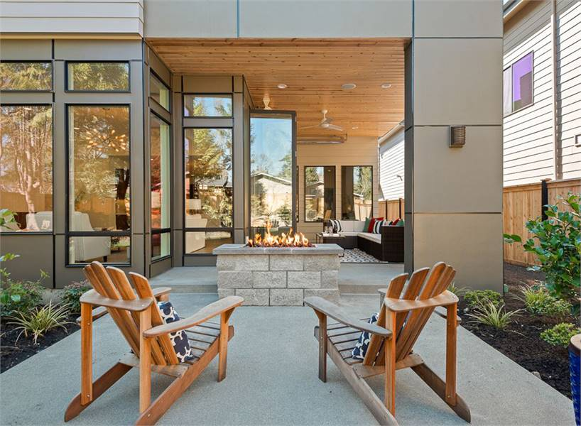 Daylight view of the open patio with a glimpse of the covered outdoor living.