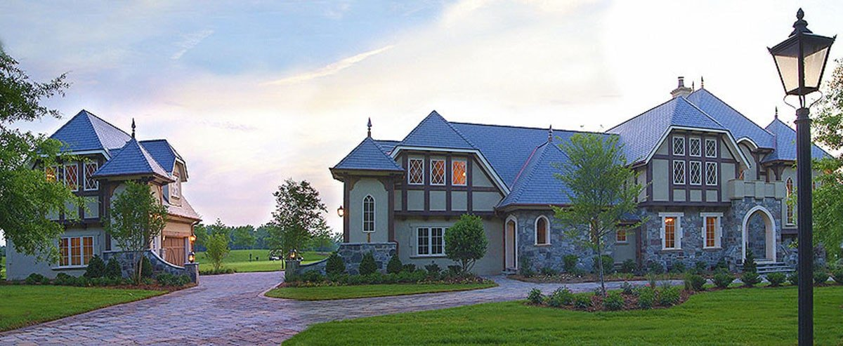 Home's front view showing the brick walkways and a separate garage complementing the house.