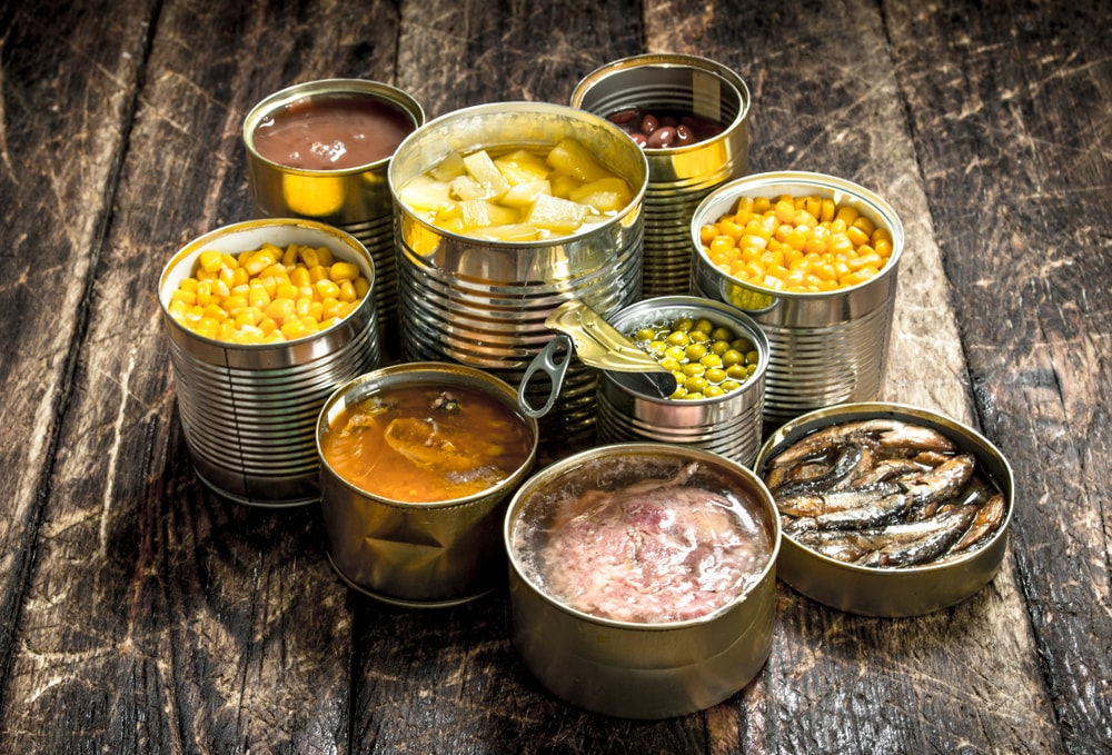 A variety of canned food in tin cans.