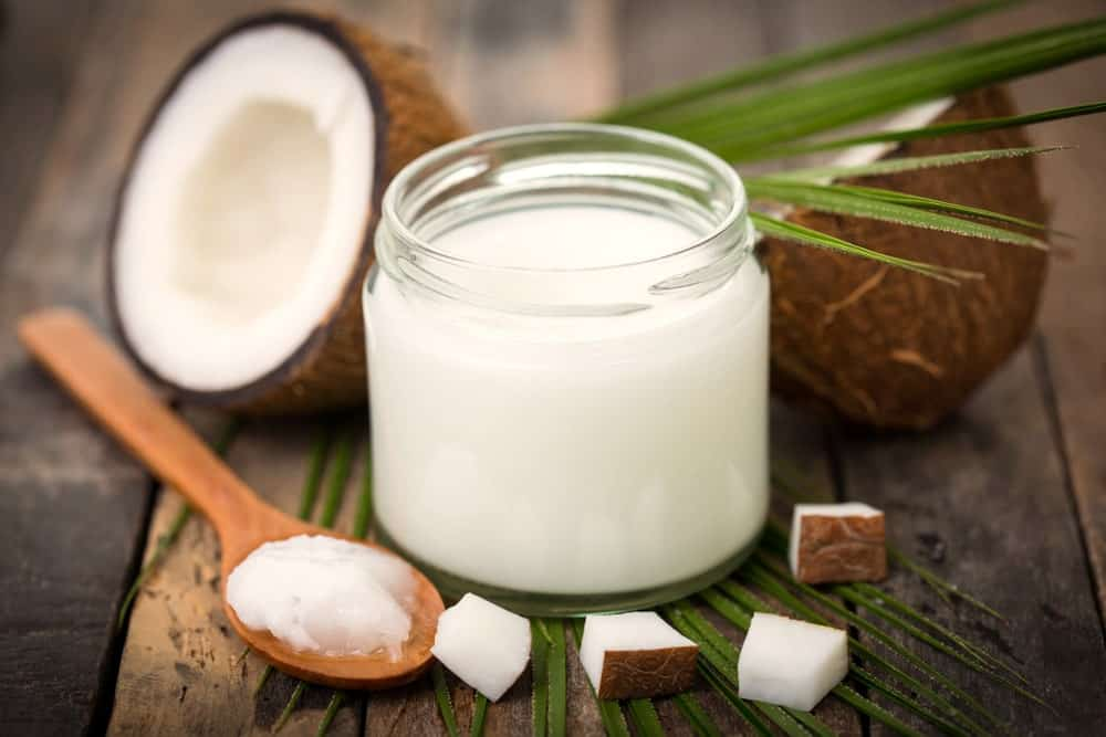 A close look at a jar of pure coconut oil.