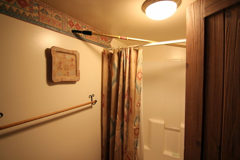 This bathroom has a shower area with a sliding curtain as cover. Images courtesy of Toptenrealestatedeals.com.