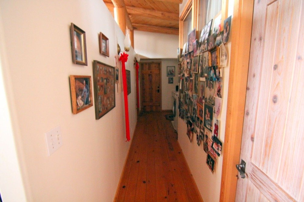 This narrow hallway features multiple picture on the wall. Images courtesy of Toptenrealestatedeals.com.