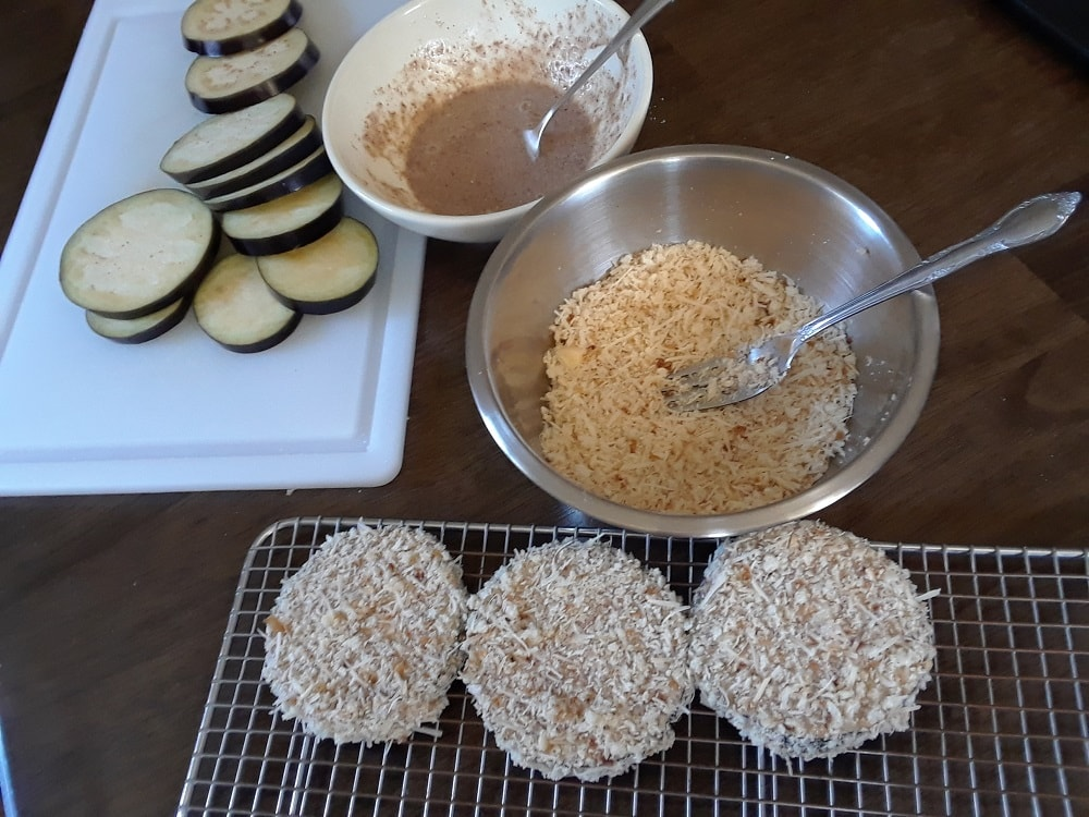 The eggplant slices are then coated with breadcrumbs.