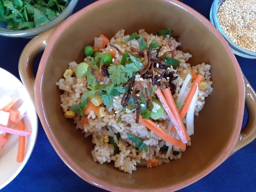 A lovely bowl of vegan fried rice with complete toppings.