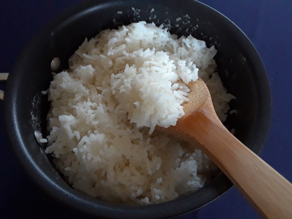 A bowl of fluffed white rice.