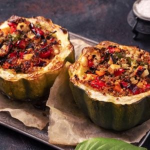 A delicious pair of vegan stuffed acorn squash.