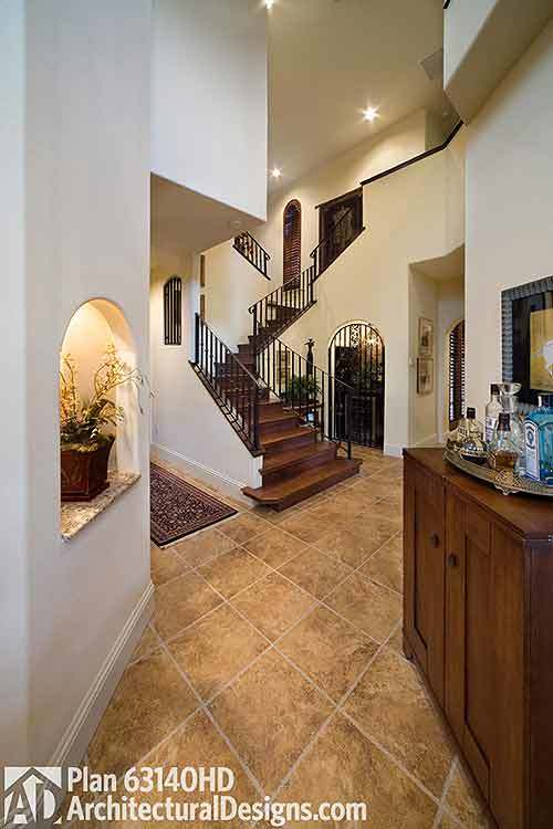 Interior with wrought iron railing and door in Tuscan-style house