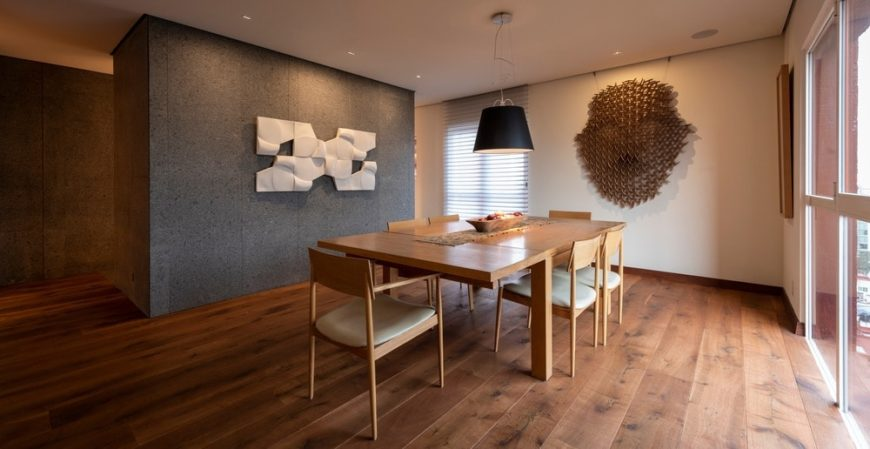 This other view of the dining area showcases another wall-mounted art piece mounted on the beige wall by the head of the dining set.
