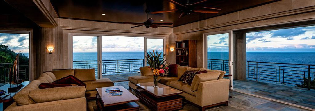 The living room has a full view of the ocean. Image courtesy of Toptenrealestatedeals.com.