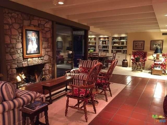 The fireplace area turns into a cozy nook in the evening. Image courtesy of Toptenrealestatedeals.com.