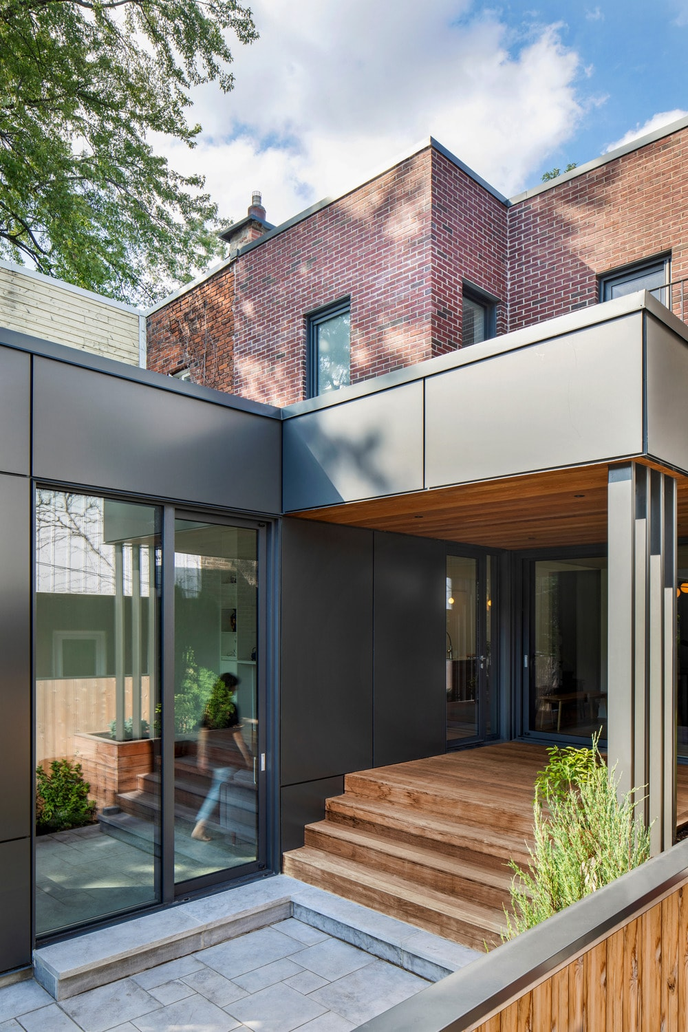 This other look of the main entrance shows that the glass door on the side is surrounded by dark gray wall panels.