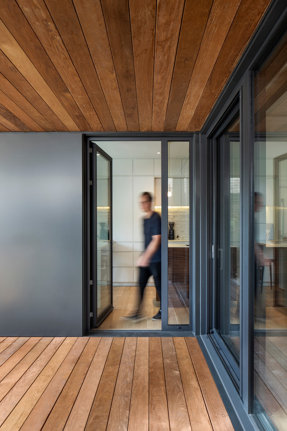 This is a closer look at the glass door of the main entrance. You can also see here that the wooden deck flooring of the entrance matches with the wooden ceiling.