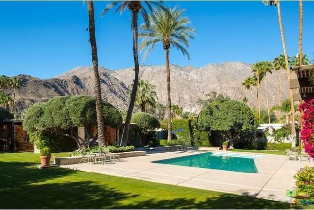 A view of the mountain scenery and the pool. Image courtesy of Toptenrealestatedeals.com.