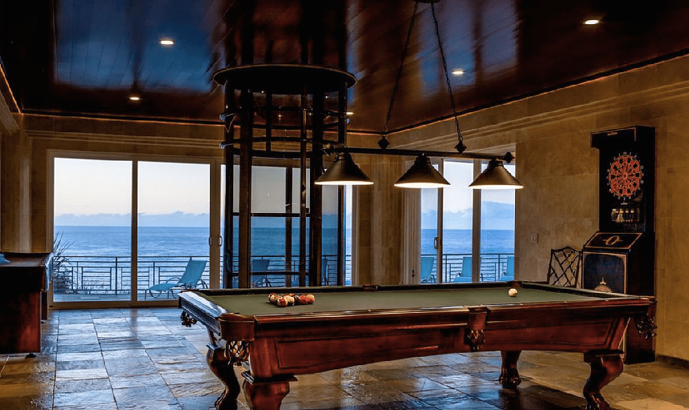 The game room has a billiards table and can be accessed by the elevator. Image courtesy of Toptenrealestatedeals.com.