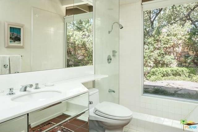 The primary bathroom with a panorama window. Image courtesy of Toptenrealestatedeals.com.