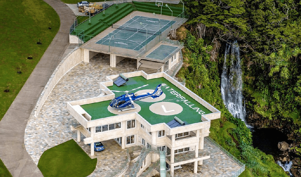 View of the helipad, tennis court, and the falls. Image courtesy of Toptenrealestatedeals.com.