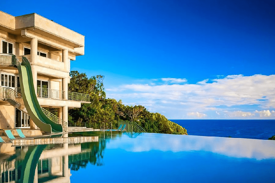 The infinity pool even has a slide. Image courtesy of Toptenrealestatedeals.com.