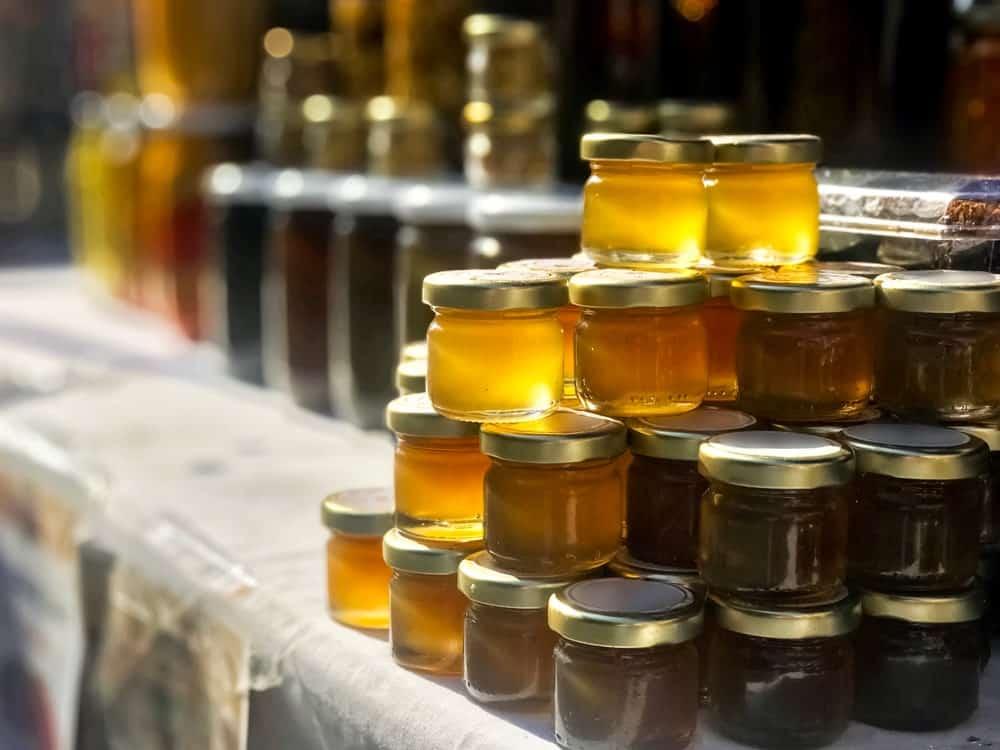 Jars of liquid honey on display.