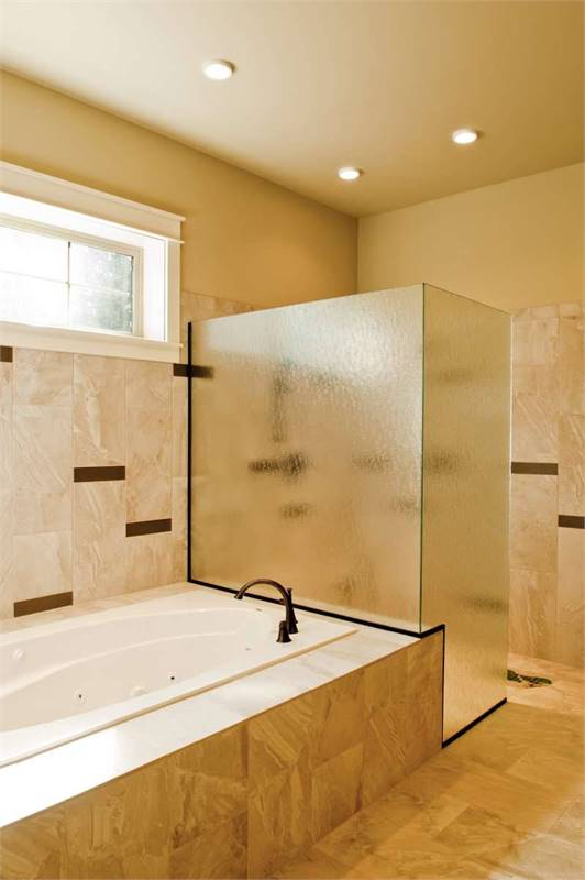 There's also a deep soaking tub and a walk-in shower enclosed in frosted glass panels.