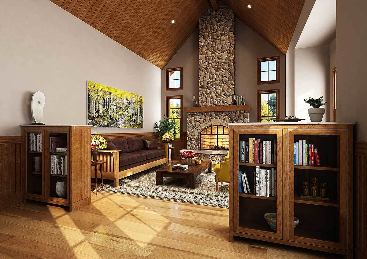 The living room offers a stone fireplace, glass-front cabinets, and comfy seats flanking a wooden coffee table.