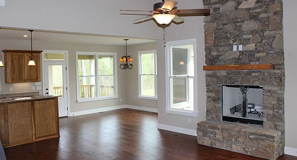 An open layout view showing the shared kitchen and dining area along with the family room.