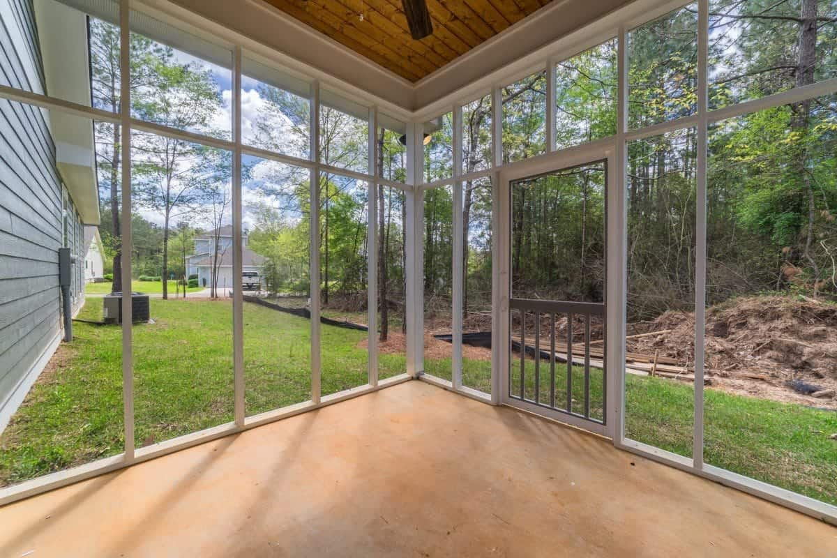 The screened porch showcases a great outdoor view and a relaxing ambiance.