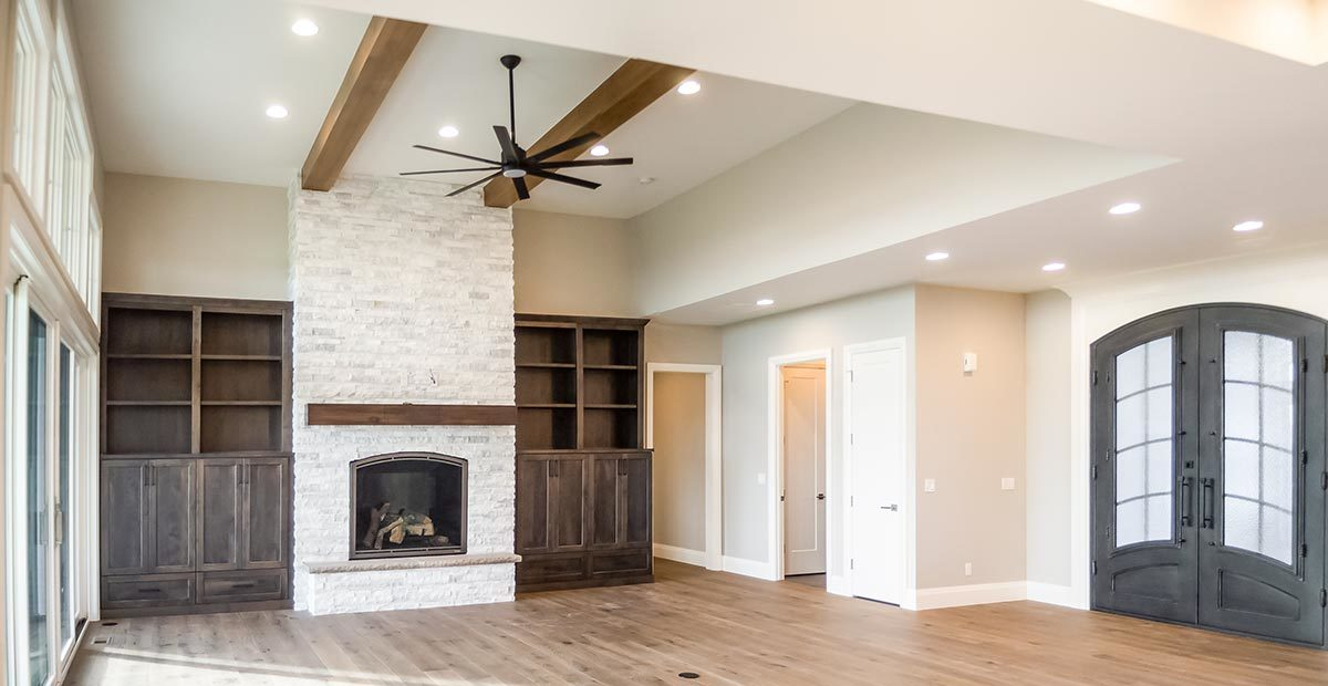 As you walked into the foyer, a spacious living room with a beamed ceiling greets you.