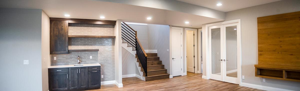 Basement level with a wet bar and a french door that opens to the exercise room.