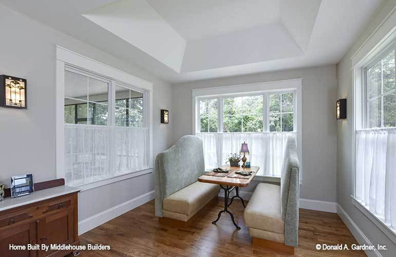 The dining room offers a wooden buffet bar, rectangular dining table, and comfy upholstered benches.