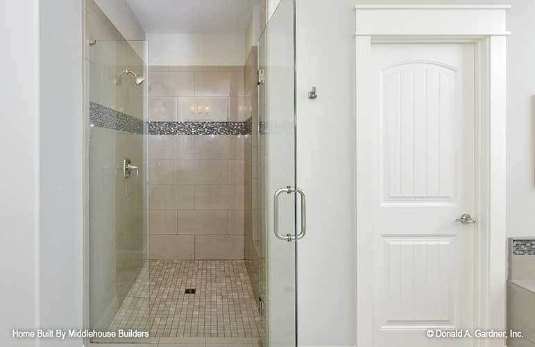 There's also a water closet and a walk-in shower accentuated with stunning mosaic tiles.