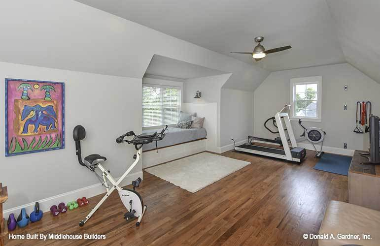 The bonus room is turned into an exercise room with a window seat.