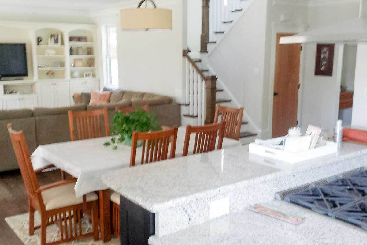 An open layout view showing the kitchen, dining area, and the living room.