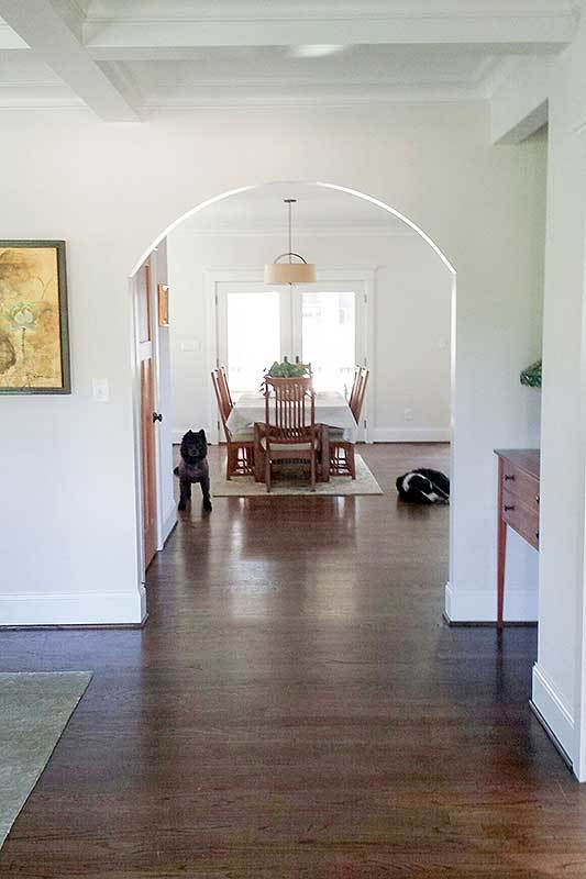 View of the dining area from the foyer. It is flooded with natural light from the french door that opens to the screened porch.