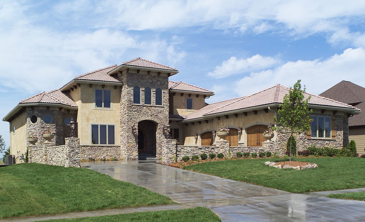 4-Bedroom Two-Story Tuscan Home with Two Curved Staircases