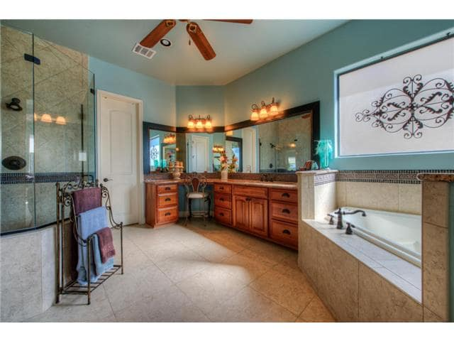 There's also a deep soaking tub fixed under the picture window that's adorned with a lovely printed shade.