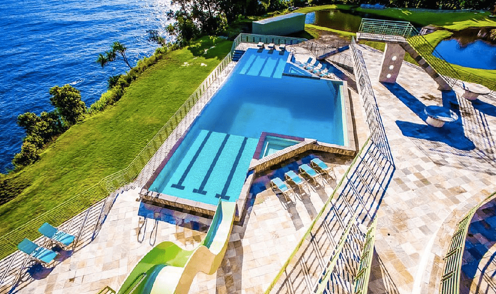 Upper view of the infinity pool and slide. Image courtesy of Toptenrealestatedeals.com.