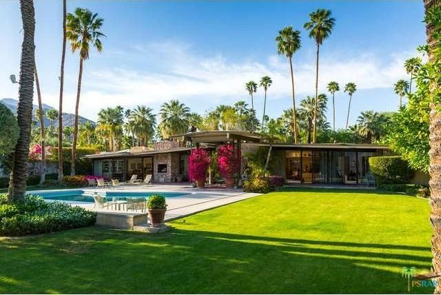 A well-manicured lawn beside the pool. Image courtesy of Toptenrealestatedeals.com.