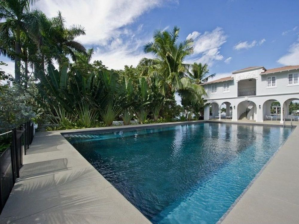 This view showcases the tropical trees on the side of the swimming pool. Images courtesy of Toptenrealestatedeals.com.
