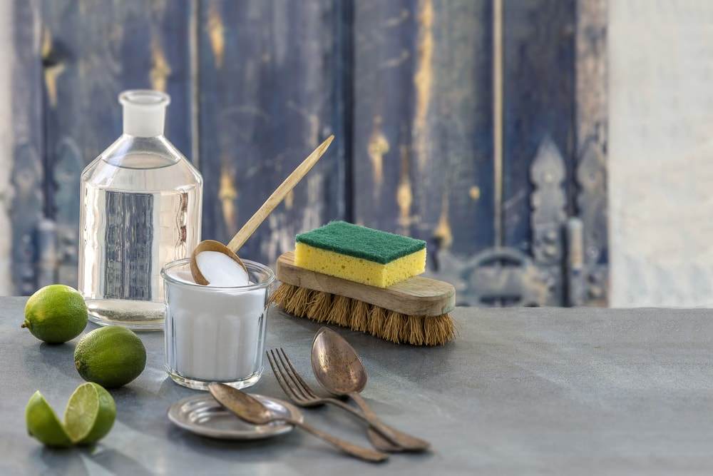 Various eco-friendly cleaning materials on a granite counter.
