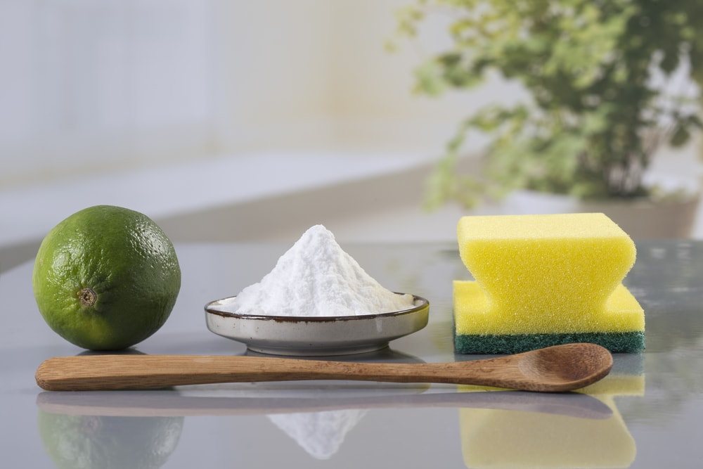 Sodium bicarbonate and Lime with a sponge and a wooden spoon.