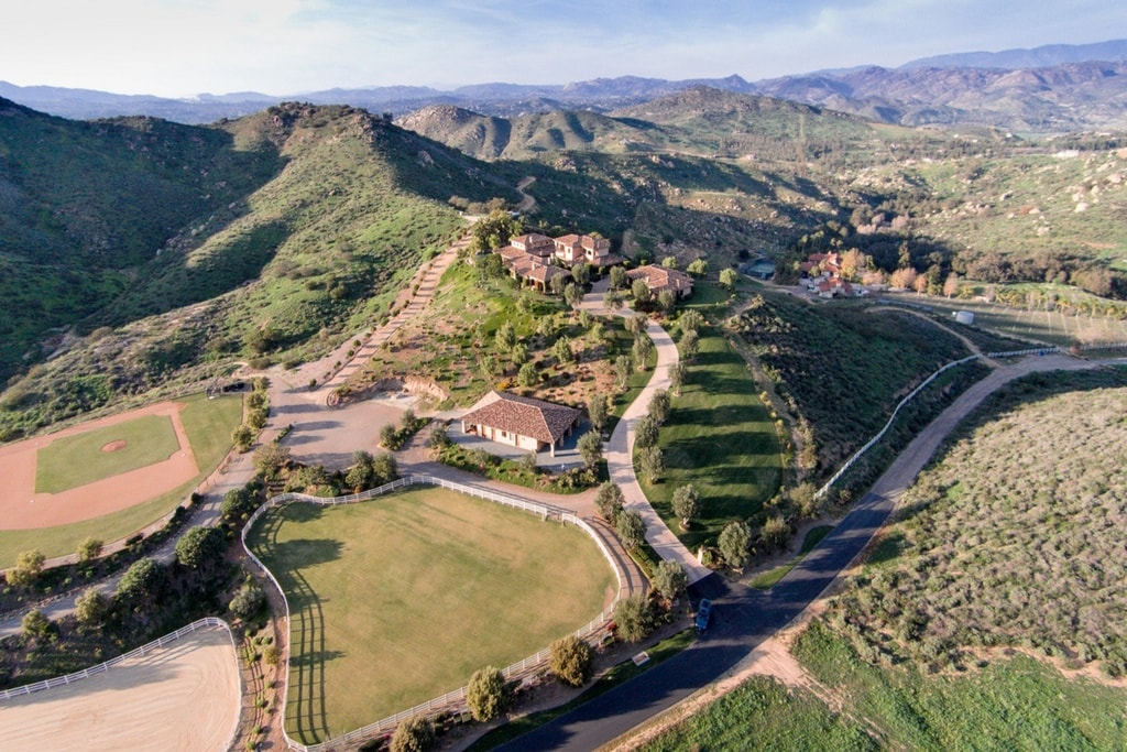 This aerial view of the property shows the hilly natural formations that give the pace an additional layer of beauty. Image courtesy of Toptenrealestatedeals.com.