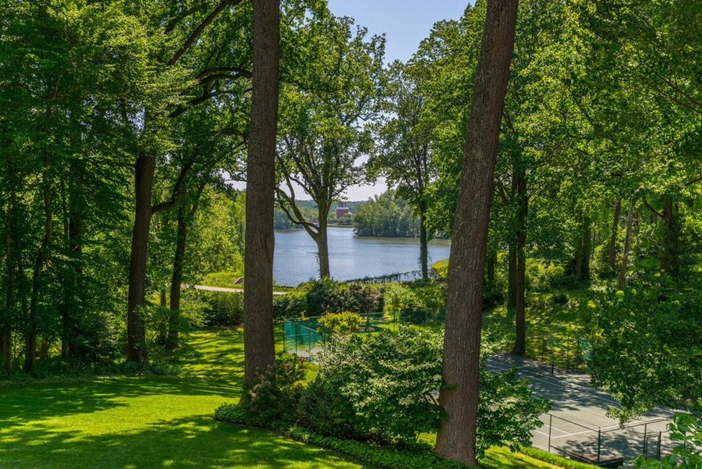This is the view afforded by the landscape of the house. Here you can see the reservoir in the distance through gaps in the tall trees and shrubs. Image courtesy of Toptenrealestatedeals.com.