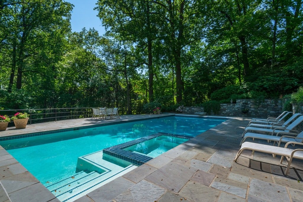 This is a closer look at the pool. Here you can appreciate more of the surrounding tall trees that bring shade to the pool as well as provide a nice background. Image courtesy of Toptenrealestatedeals.com.