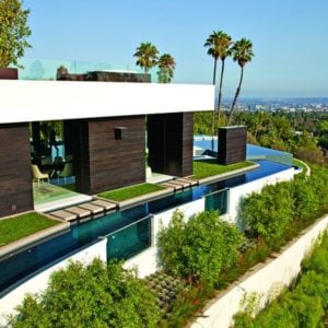 This is an aerial view of the house that showcases the moat surrounding the house that gives it an island-style look. You can also see here the sweeping views of the city below. Image courtesy of Toptenrealestatedeals.com.