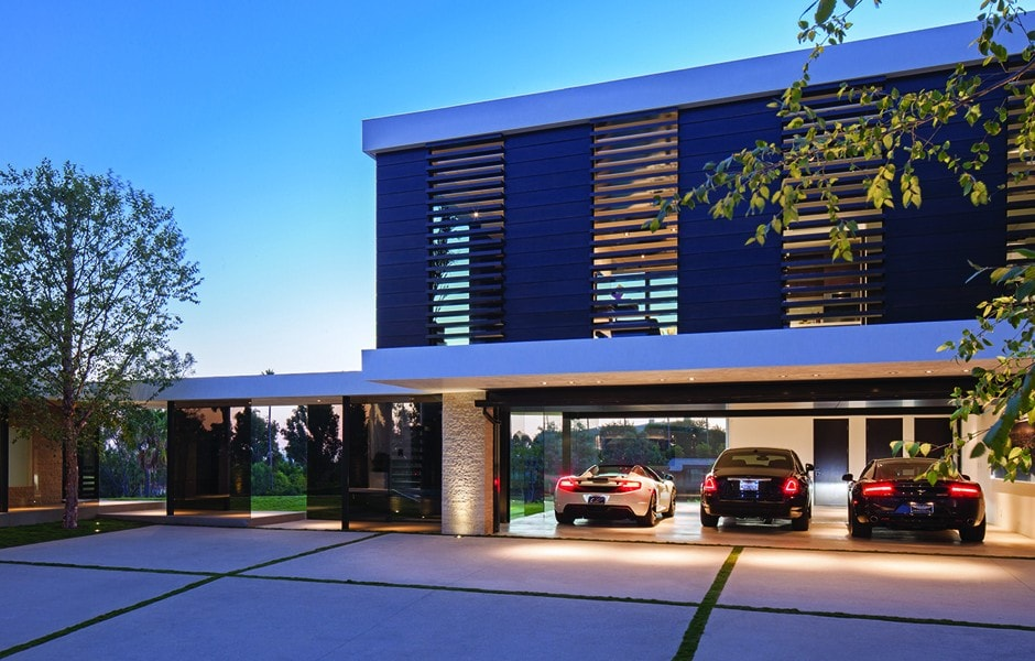 This is a front view of the contemporary-style house showcasing the three-car garage. Image courtesy of Toptenrealestatedeals.com.