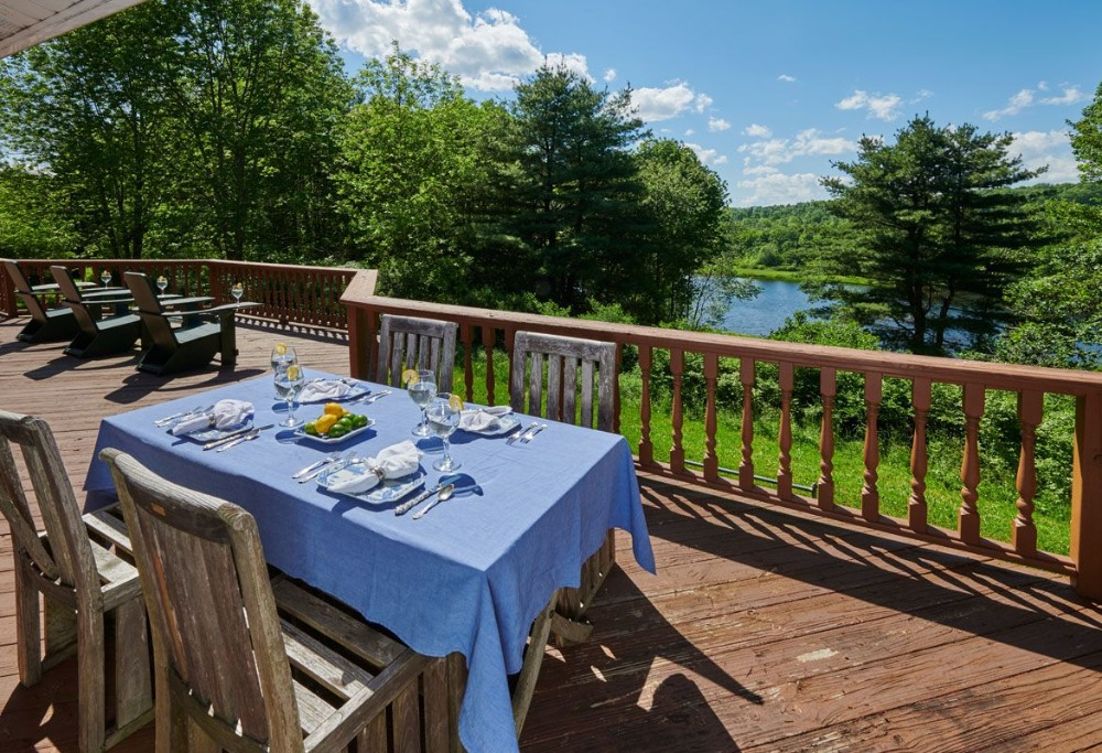 There's also an outdoor dining table and chairs set on the home's balcony. Image courtesy of Toptenrealestatedeals.com.