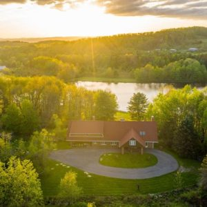 This aerial view is just so magical. It features the house and the lovely landscape under the setting sun. Image courtesy of Toptenrealestatedeals.com.