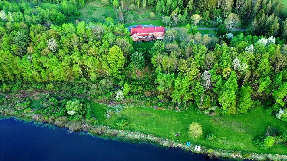 Another aerial view showcasing the natural landscape surrounding the property. Image courtesy of Toptenrealestatedeals.com.