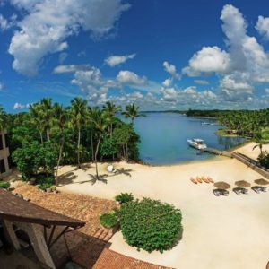 This is an aerial view of the entire beachfront of the property. Here you can see the various sitting areas by the beach and the borders of tall tropical trees on both sides. Image courtesy of Toptenrealestatedeals.com.