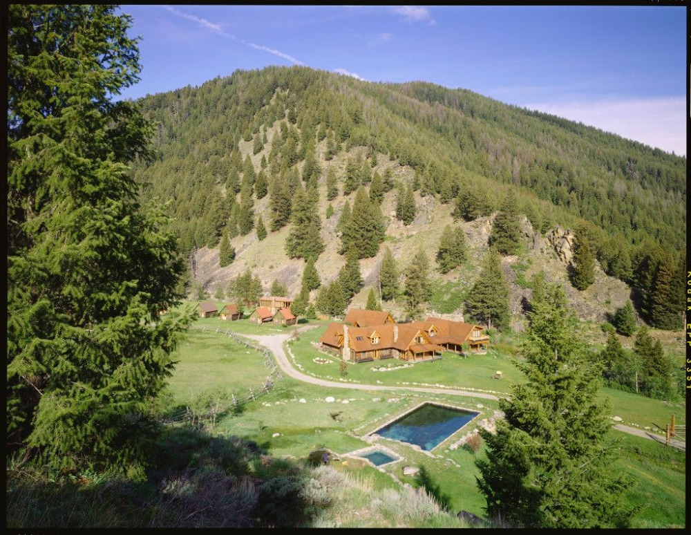 Aerial view of the property showcasing the natural landscape surrounding it. Image courtesy of Toptenrealestatedeals.com.